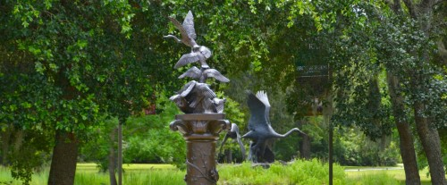 Metal sculpture of birds taking flight. Brookgreen Gardens, SC     photo © ces