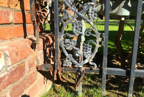 Wrought iron and brick fence        photo © ces